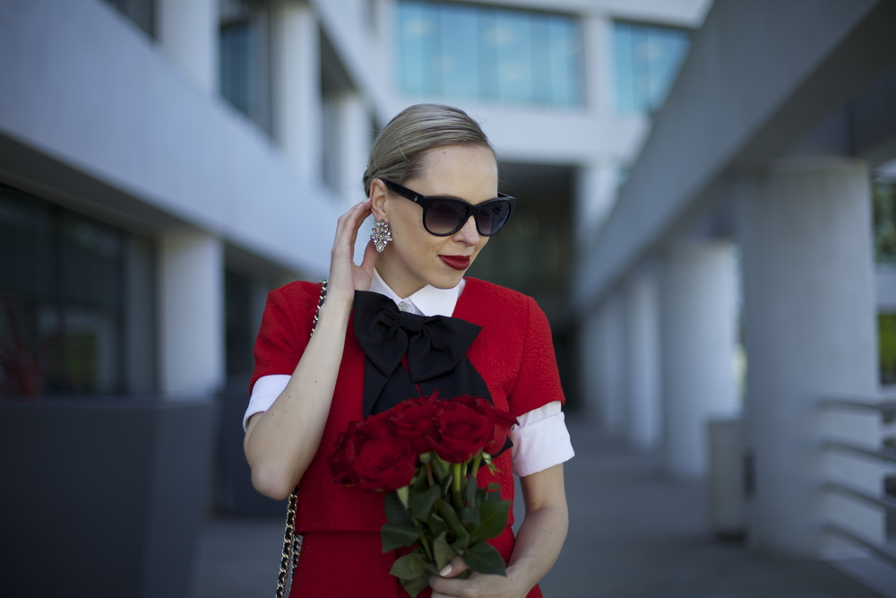 Zara red dress featured by top US fashion blog, Lombard and Fifth: image of a woman wearing a Zara red dress, J Crew white shirt, ASOS bow tie, Rebecca Minkoff bag, Benevolent Jewels earrings and DSW shoes